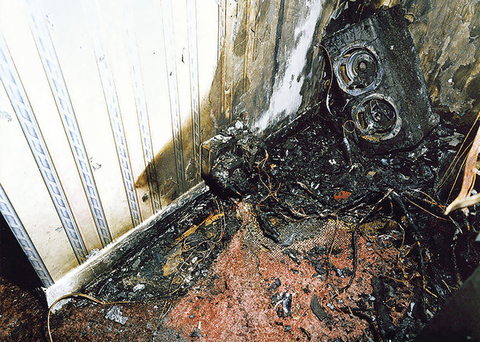 A fire caused by an overloaded electrical circuit though the use of too many plugs.