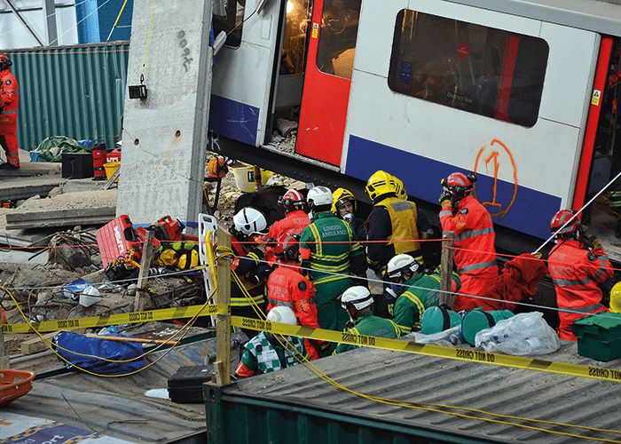 Fire & Rescue and Paramedic crews work to release casualties trapped in the wreckage of the Underground train.