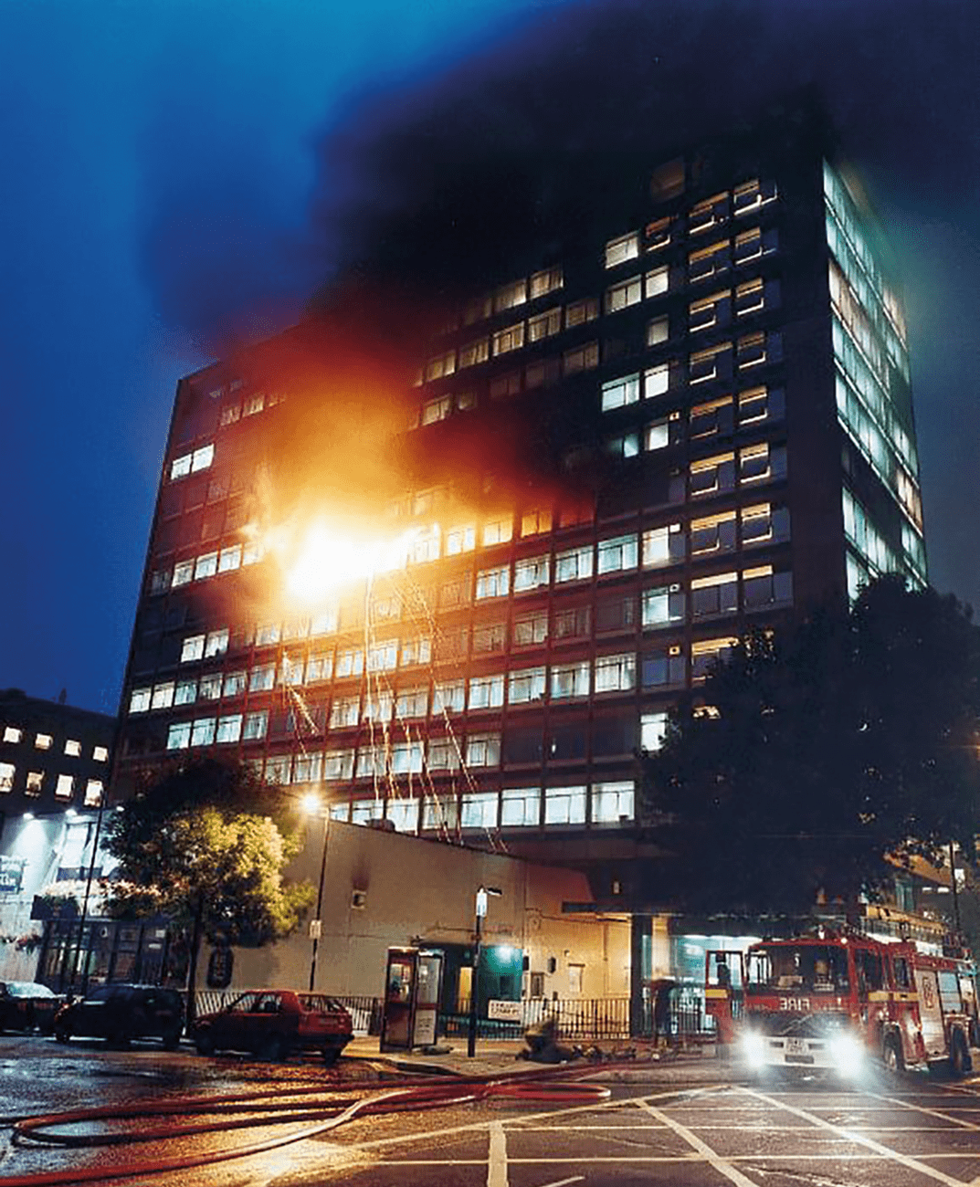 A dramatic nightime view of a serious fire in tower accommodation.