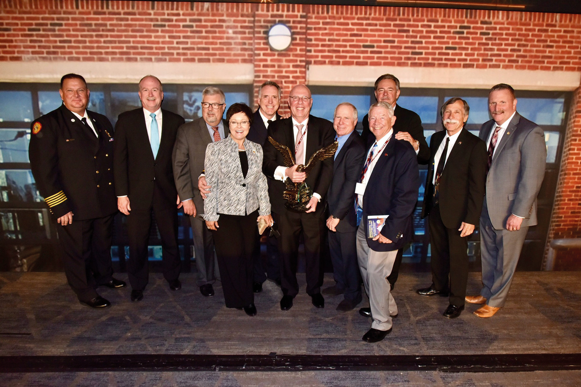 The author is flanked by NFPA President & CEO Jim Pauley (second from the left) and members of the Metro Chiefs after receiving the Congressional Fire Services Institute (CFSI) Mason Langford Award last year.