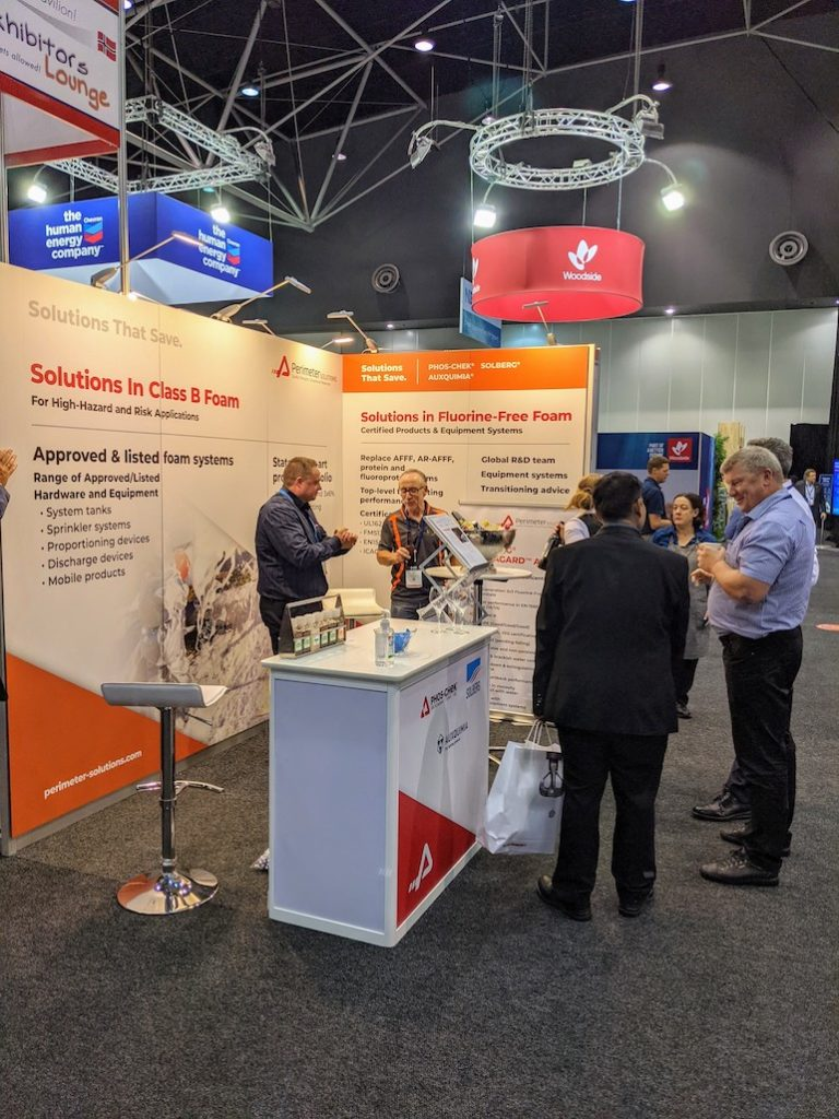 David Phoenix (R) talking to a client on the Perimeter Solutions booth at the AOG Show. (Perimeter Solutions)